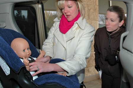 Jessica Arp of Ch. 3 (WISC) shows how to properly buckle in a child and install a child safety seat. She received a perfect score in the competition.
