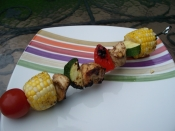 Grilled basil chicken, corn and pepper kabobs