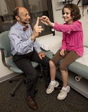UW Health pediatric neurologist with patient