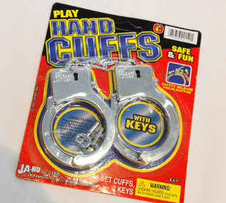 "These toy handcuffs are listed as ""safe and fun,"" but contain 20 times the legal amount of antimony, according to the ""Trouble in Toyland"" report."