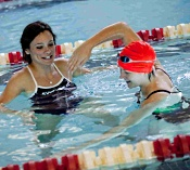 UW Health Fitness Center News: Swim instructor and student