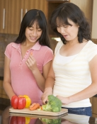 Pediatric Fitness Clinic: Mom and Daughter Cooking
