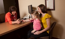 A mother and daughter in the reception room at Madison Surgery Center.