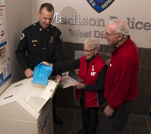 The MedDrop program distributes small, blue opaque bags clearly labeled with instructions for disposing of old, unused medications, including where they can be dropped off at one of 13 official MedDrop box locations in Dane county.