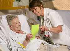 Transitional Care Program nurse, Peggy Troller, MS, RN, discusses discharge goals with a patient to ensure coordination of care before, during and after the hospital stay.