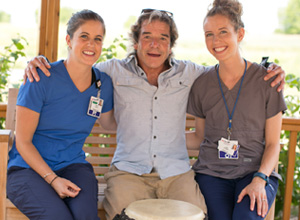 Jim Flickinger catches up with his physical and occupational therapists at UW Health Rehabilitation Hospital, Casey DiTroia and Julie Przywara