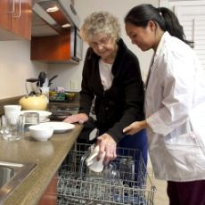 patient and therapist in the adaptive kitchen; UW Health Rehabilitation Hospital; Madison, Wisconsin