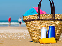 beach basket with sunscreen; UW Health Transformations Jeune Skin Care sunscreen questions and answers; Madison, Wisconsin