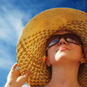 woman wearing a sun hat; How to Repair Summer Skin Damage; UW Health Transformations Jeune Skin Care; Madison, Wisconsin