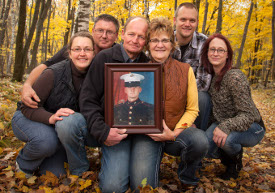 The family of donor Michael Hinkens with his photo