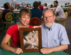 Meredith, Henry's mother, and Walter, the recipient of Henry's heart, with his photo on the Memorial Union Terrace
