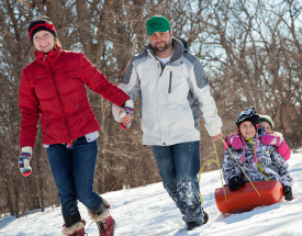The Pryne family enjoys some time in the snow