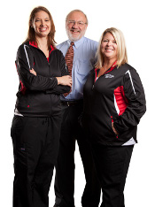 Transplant nurses Trisha Mason and Stacy Moneypenny with abdominal transplant clinic director Mike Armbrust