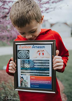 Jackson displays his special plaque, presented by his kidney donor, Lindsey Bittorf. Photo by Gutzman Photography.
